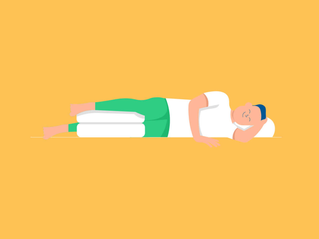 An illustration of how a side sleeper should put pillows below the front leg